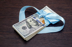 dollar bills in blue gift ribbon Stock Photos