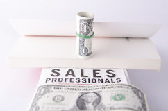 DOLLAR BILLS AND BOOKS Stock Photography