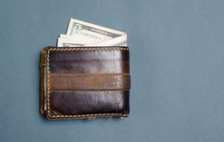 Dollar bills in brown leather wallet. Dollar bills in a brown leather wallet Stock Images