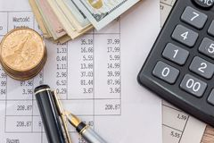 Dollar bills with business documents, pen  and calculator. As background Stock Photography
