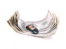 Dollar bills and car toy Stock Image