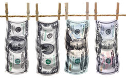 Dollar bills on clothesline Stock Images