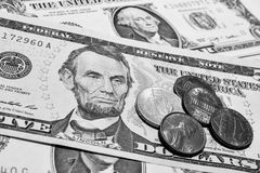 Dollar bills with coins. Black&white royalty free stock image
