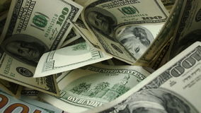 Dollar bills and coins stock footage