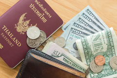 Dollar bills coins wallet passport Royalty Free Stock Image