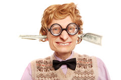 Dollar bills coming out of my ears Royalty Free Stock Image