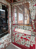 Dollar bills cover saloon doors. Old West saloon doors adorned with dollar bills Stock Photography