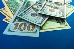 Dollar bills of different denominations royalty free stock images