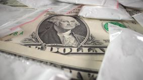 Dollar bills and drugs in bags