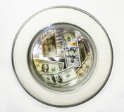 Dollar bills in the drum of the washing machine Stock Images