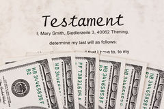 Dollar bills and english testament Royalty Free Stock Images