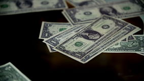 Dollar bills fall on the table stock footage