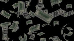 Dollar bills falling on black stock video footage
