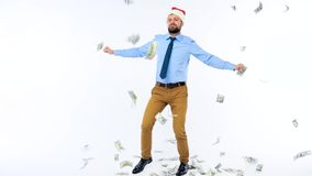 Dollars falling on formally dressed man in the Santa Claus hat. Dollar bills falling on formally dressed man in the Santa Claus hat stock video footage