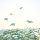Dollar bills falling into a pile on sky background. Royalty Free Stock Photography