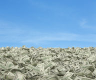 Dollar bills falling. On sky background Royalty Free Stock Photography