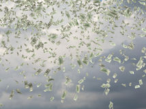 Dollar bills falling. On a sky background Stock Photography