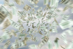 Dollar bills falling. On a sky background Royalty Free Stock Images
