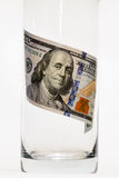 100 dollar bills that are in the glass.  Royalty Free Stock Photos
