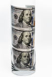 100 dollar bills that are in the glass.  Royalty Free Stock Photography