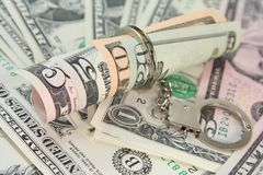 Dollar bills with handcuffs Royalty Free Stock Photo