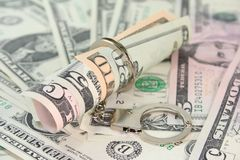 Dollar bills with handcuffs Royalty Free Stock Photography