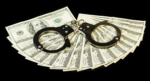 Dollar bills and handcuffs Royalty Free Stock Image