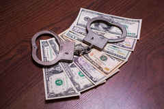 Dollar bills and handcuffs Royalty Free Stock Photo