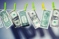 Dollar bills hanging and drying on clothesline. The concept of money laundering Stock Images