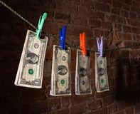 Dollar bills hanging on a rope Royalty Free Stock Photos