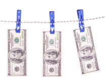 Dollar bills hanging on rope attached with clothes pins. Royalty Free Stock Photo