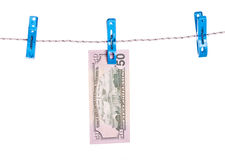 Dollar bills hanging on rope attached with clothes pins. Stock Image