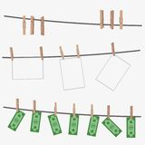 Dollar bills hanging on rope attached with clothes pins. Royalty Free Stock Images