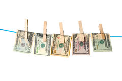 Dollar bills drying on a rope. Dollar bills hanging on a rope with wooden pegs Stock Images