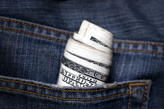 Dollar bills in jeans pocket Stock Images