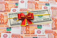 Dollar bills laying over rouble background Stock Photography