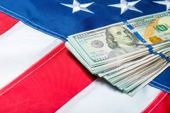 100 dollar bills lying on the stars of the American flag. Close-up shot stock image