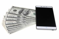 Dollar bills and mobile telephone isolated Stock Photography