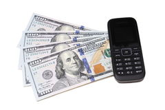 Dollar bills and mobile telephone Royalty Free Stock Photography
