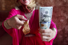 Dollar bills money with gold holded by muslim woman Stock Image