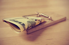 Dollar bills in a mousetrap with a retro effect Stock Photography