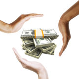 Dollar bills with multiracial human hands around Royalty Free Stock Images