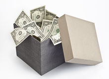 Dollar bills in open box Stock Image