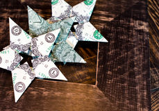 Dollar bills origami stars on old wood frames background Royalty Free Stock Photo