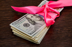 dollar bills in pink gift ribbon Stock Photography