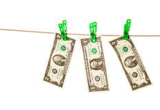Dollar bills pinned to a clothesline Royalty Free Stock Photo