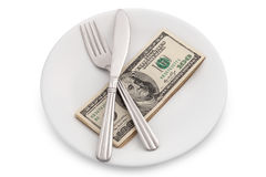 Dollar bills on plate Royalty Free Stock Photos