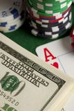 Dollar bills, playing cards and poker chips royalty free stock images