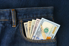 Dollar Bills in the pocket of jeans.  Royalty Free Stock Images