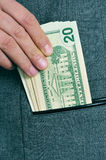 Dollar bills in the pocket Royalty Free Stock Photos